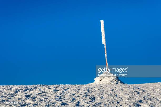 low angle view of snow covered against blue sky - babia góra mountain stock pictures, royalty-free photos & images
