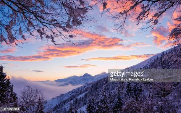 Low Angle View Of Snow Covered Mountains During Sunset