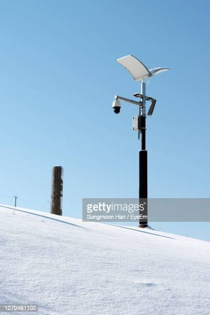 low angle view of snow with street light against clear sky - gwangju stock pictures, royalty-free photos & images