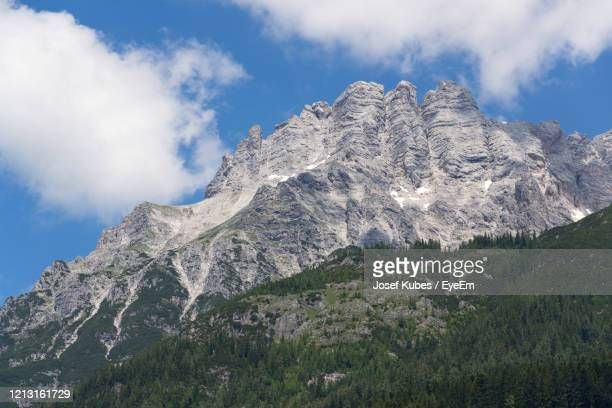 low angle view of snowcapped mountain against sky - leogang stock pictures, royalty-free photos & images