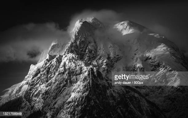 low angle view of snowcapped mountain against sky - andy dauer stock pictures, royalty-free photos & images