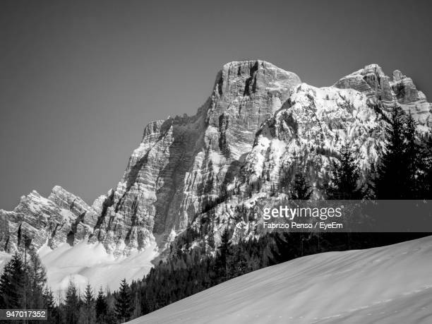 low angle view of snowcapped mountains against clear sky - fabrizio penso foto e immagini stock