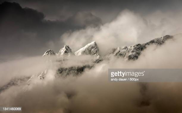 low angle view of snowcapped mountains against sky - andy dauer stock pictures, royalty-free photos & images