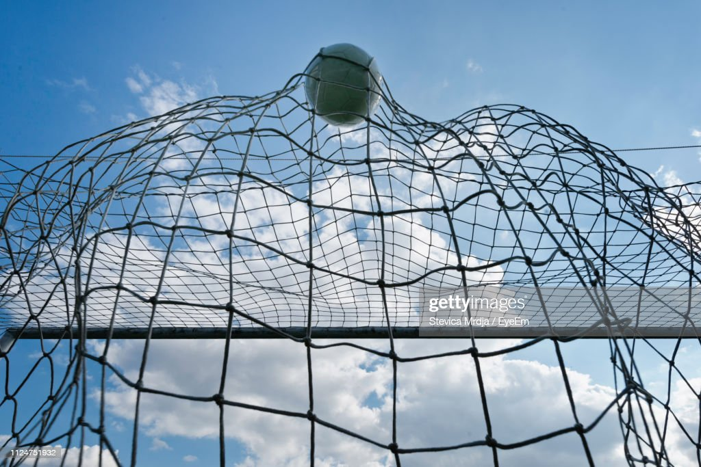 Low Angle View Of Soccer Ball In Goal Post : ストックフォト