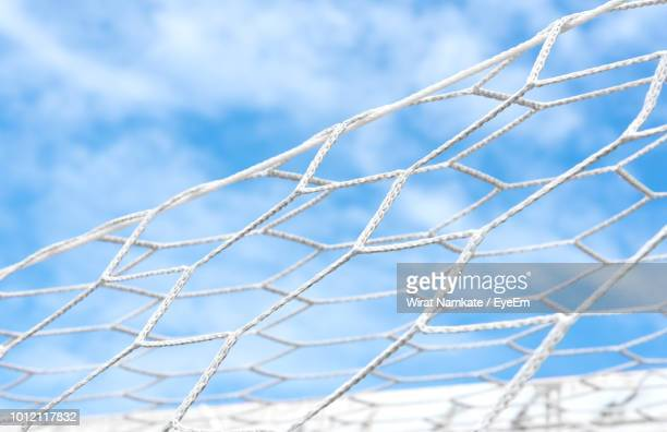 low angle view of soccer net against sky - soccer goal stock pictures, royalty-free photos & images