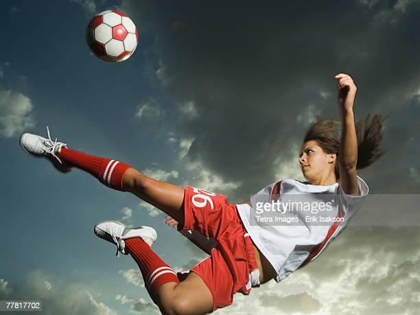 low angle view of soccer player jumping - kicking stock pictures, royalty-free photos & images