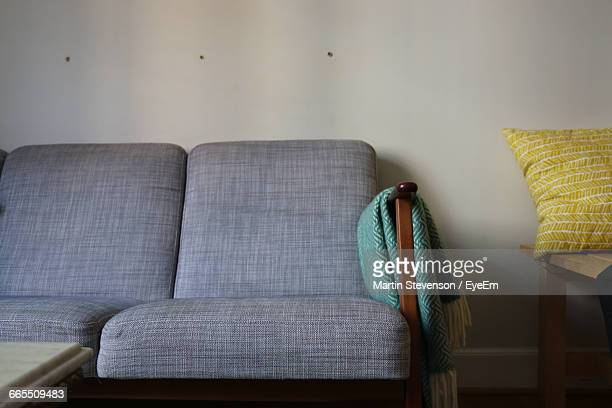 Low Angle View Of Sofa Against Wall At Home