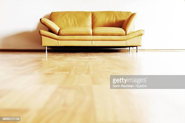 low angle view of sofa on floor at home - low angle view stock pictures, royalty-free photos & images