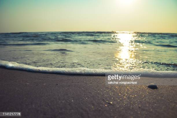 low angle view of soft wave on beach against sky during sunrise, thailand - seascape stock pictures, royalty-free photos & images