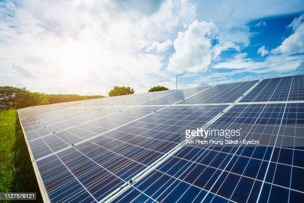 low angle view of solar panels against sky - renewable energy stock pictures, royalty-free photos & images