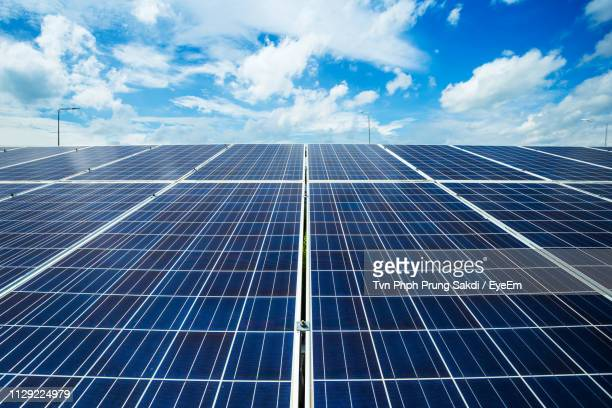 low angle view of solar panels against sky - close to stock pictures, royalty-free photos & images