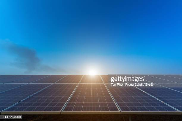 low angle view of solar panels against sky - solar panel stock pictures, royalty-free photos & images