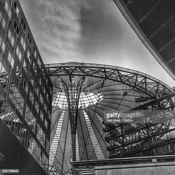 low angle view of sony center against sky in city - sony center berlin stock pictures, royalty-free photos & images