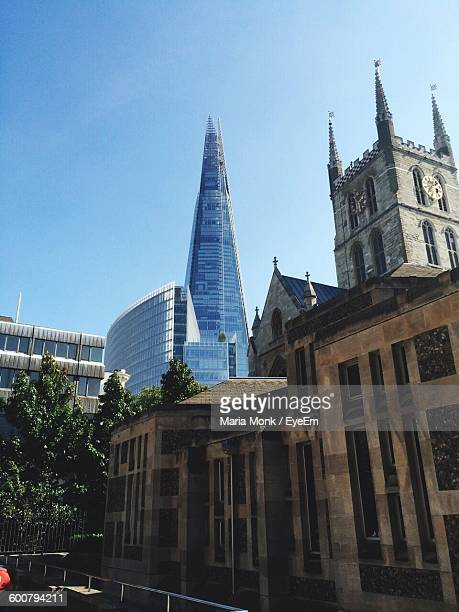 Low Angle View Of Southwark Cathedral And Shard London Bridge In City Against Sky