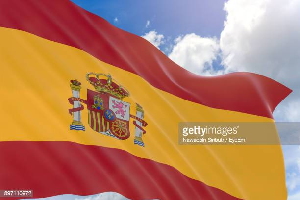 Low Angle View Of Spanish Flag Against Sky