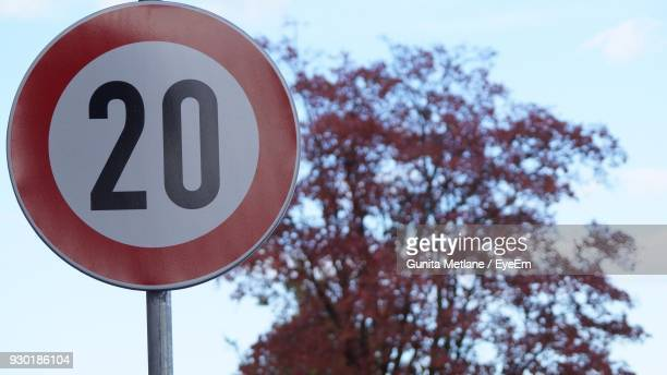 low angle view of speed limit sign against tree - number 20 stock pictures, royalty-free photos & images
