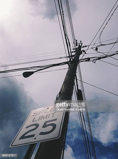 Low Angle View Of Speed Limit Sign On Electricity Pylon