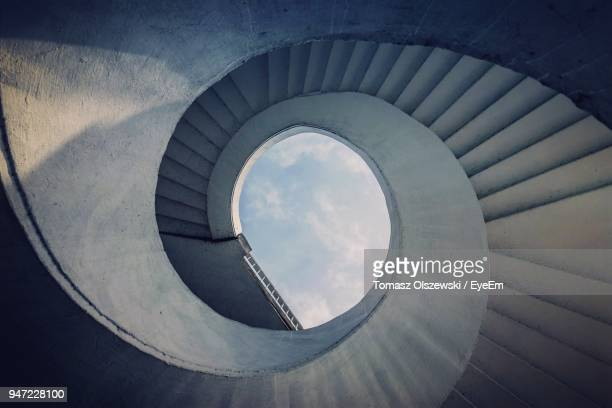 low angle view of spiral stairs against sky - concentric stock pictures, royalty-free photos & images