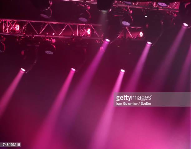 low angle view of spotlights at concert - stage light stock pictures, royalty-free photos & images