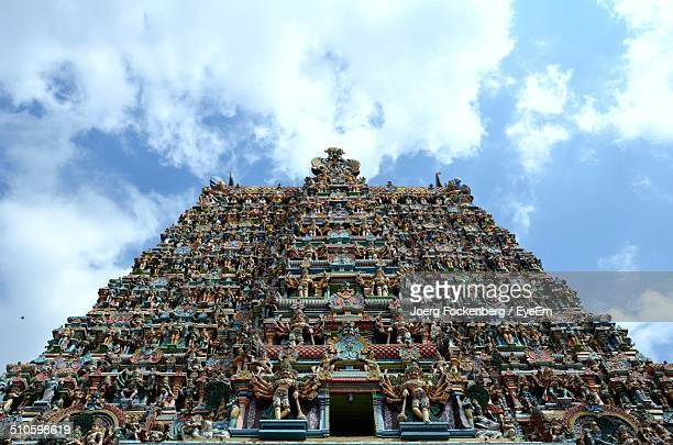 Low angle view of Sri Meenakshi Temple against cloudy sky