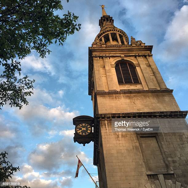low angle view of st mary-le-bow against cloudy sky - st mary le bow church stock pictures, royalty-free photos & images