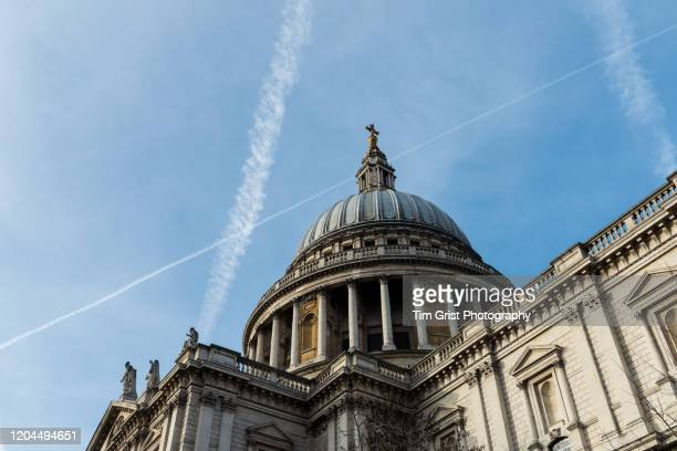 low angle view of st paul's cathedral, london, uk. - tim grist stock pictures, royalty-free photos & images
