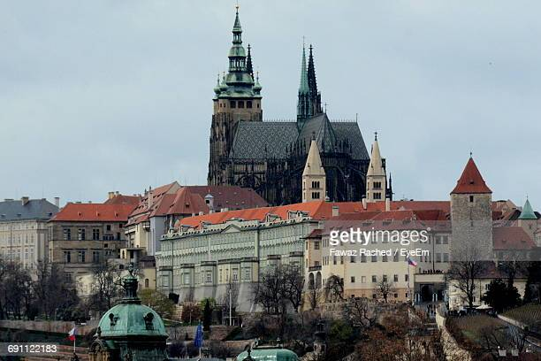 low angle view of st vitus cathedral and buildings against sky - st vitus's cathedral stock pictures, royalty-free photos & images