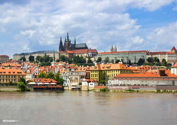 low angle view of st. vitus's cathedral over vltava river - hradcany castle stock pictures, royalty-free photos & images
