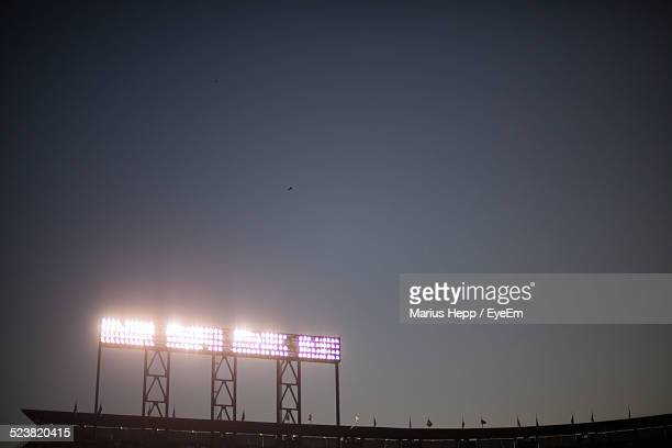 Low Angle View Of Stadium Lights