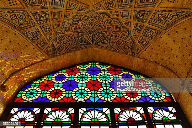 Low Angle View Of Stained Glass Window And Ceiling In Nasir Al-Mulk Mosque