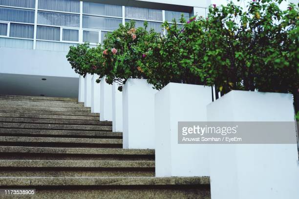 low angle view of staircase against building - anuwat somhan stock photos and pictures