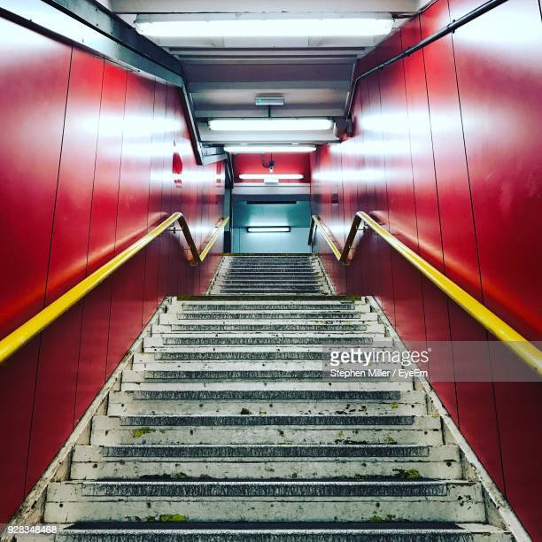 low angle view of staircase at subway station - red tube stock pictures, royalty-free photos & images