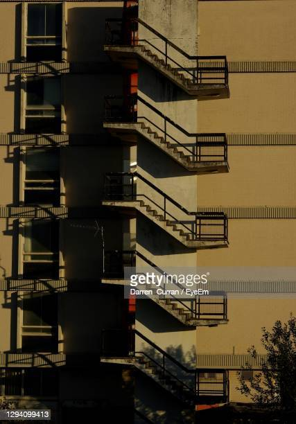 low angle view of staircase by building - curran stock pictures, royalty-free photos & images