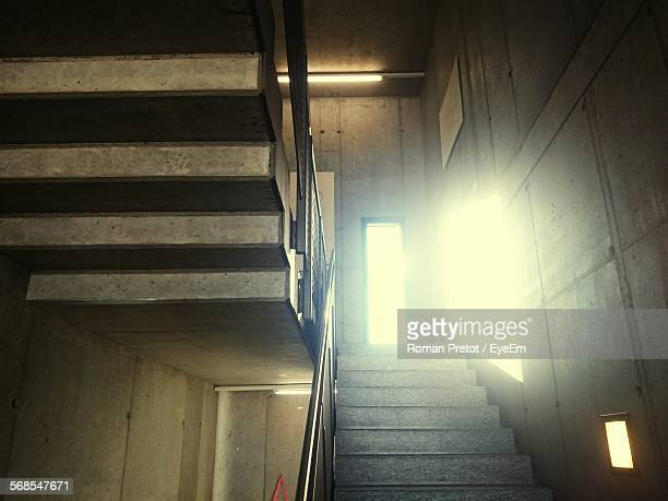 low angle view of staircase in building - roman pretot stock-fotos und bilder