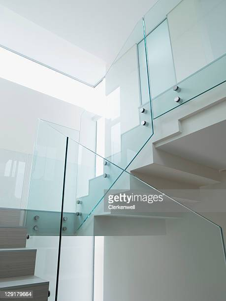 Low angle view of staircase with glass railing