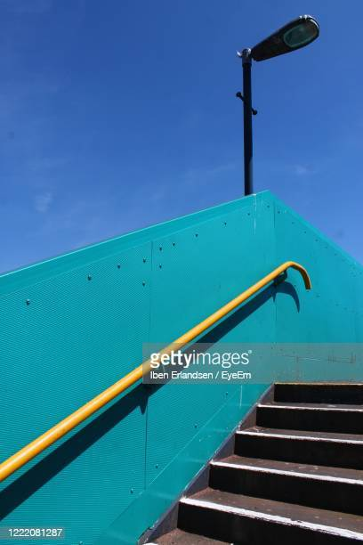 low angle view of stairs against blue sky - staircase stock pictures, royalty-free photos & images