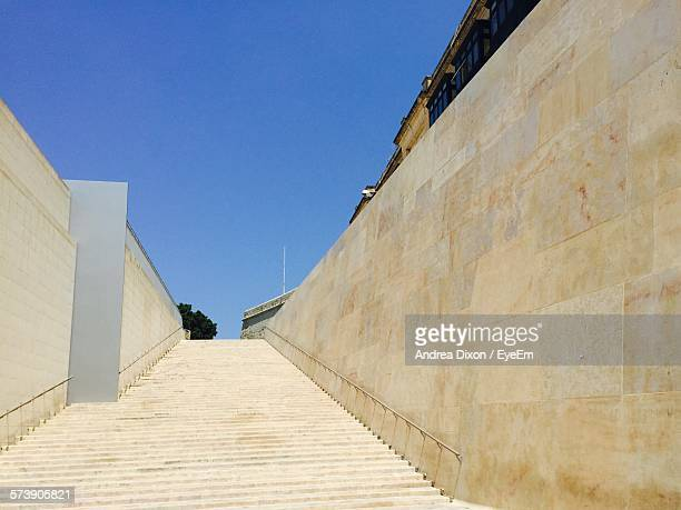 low angle view of stairs along walls - maltese islands stock photos and pictures