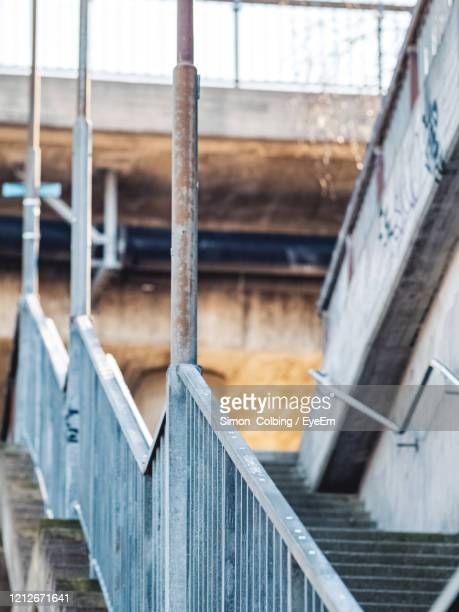 low angle view of stairs leading to high way - colbing stock pictures, royalty-free photos & images