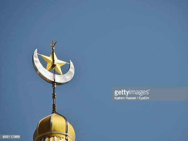 Low Angle View Of Star And Crescent On Minaret Against Clear Sky