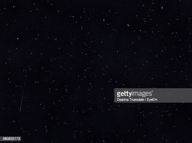 low angle view of star field at night - star field stock photos and pictures