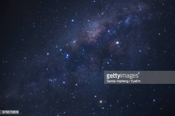 low angle view of star field at night - cielo stellato foto e immagini stock