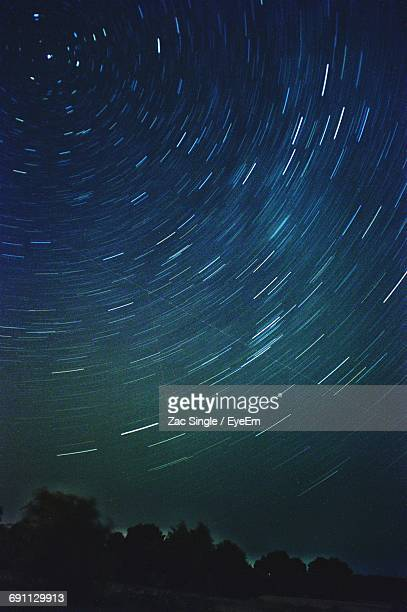 Low Angle View Of Star Trails At Night