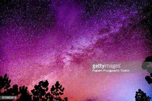 low angle view of starry sky - lilac stock photos and pictures