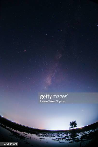 low angle view of stars against sky at night - fish eye foto e immagini stock