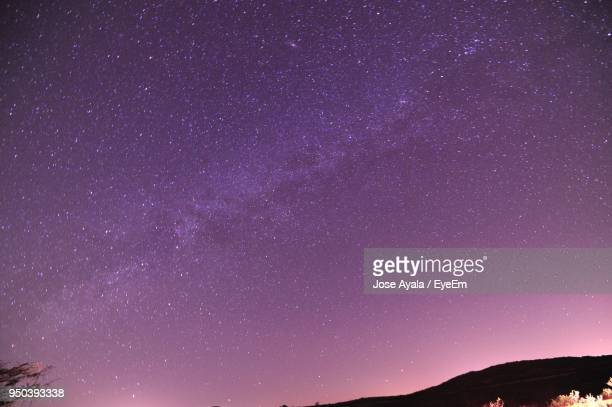 low angle view of stars against star field at night - jose ayala fotografías e imágenes de stock