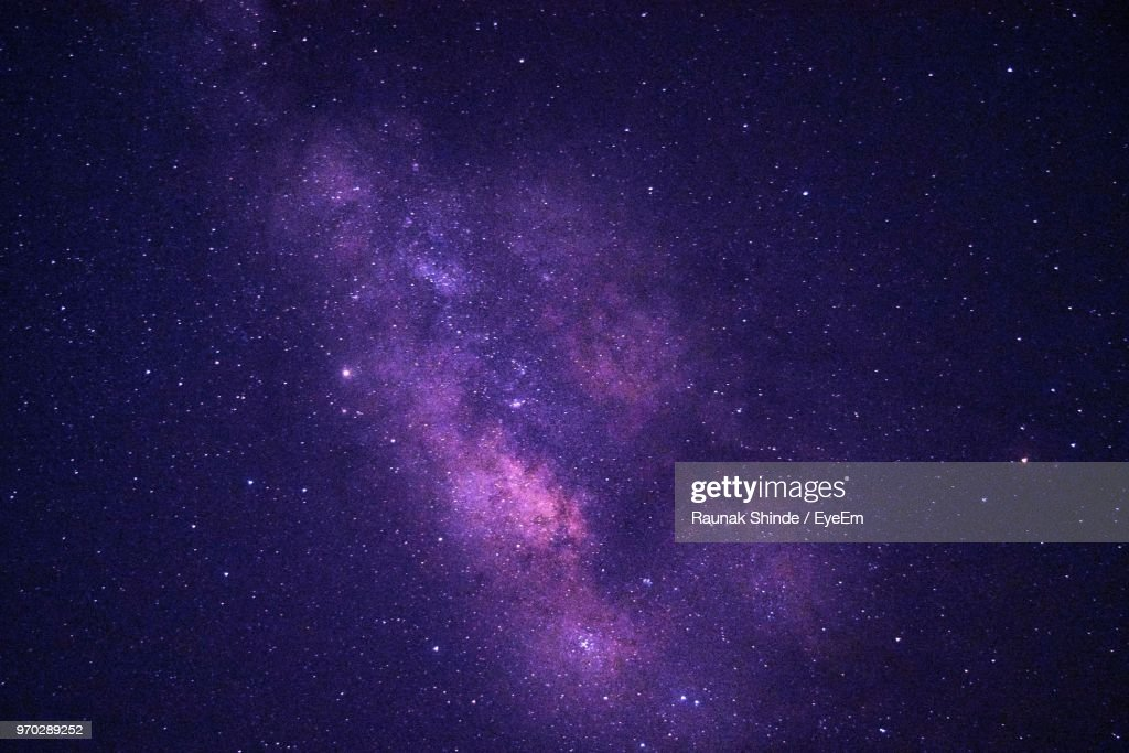 Low Angle View Of Stars Against Star Field At Night : Stock Photo