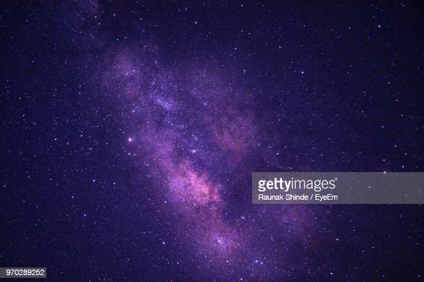 low angle view of stars against star field at night - purple stock pictures, royalty-free photos & images
