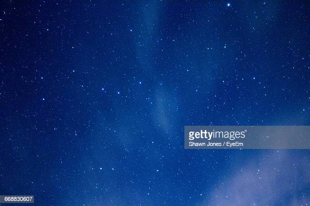 low angle view of stars in sky - ethereal stock pictures, royalty-free photos & images
