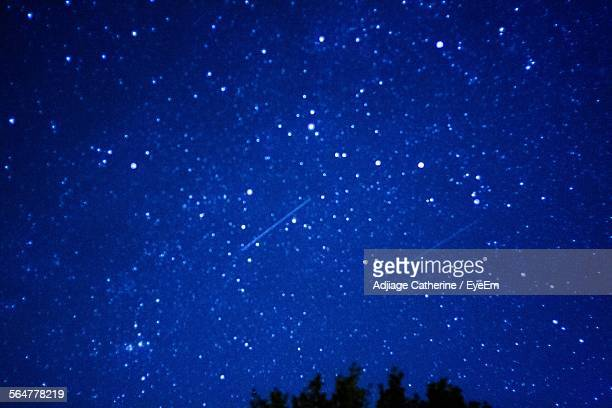 Low Angle View Of Stars On Blue Sky