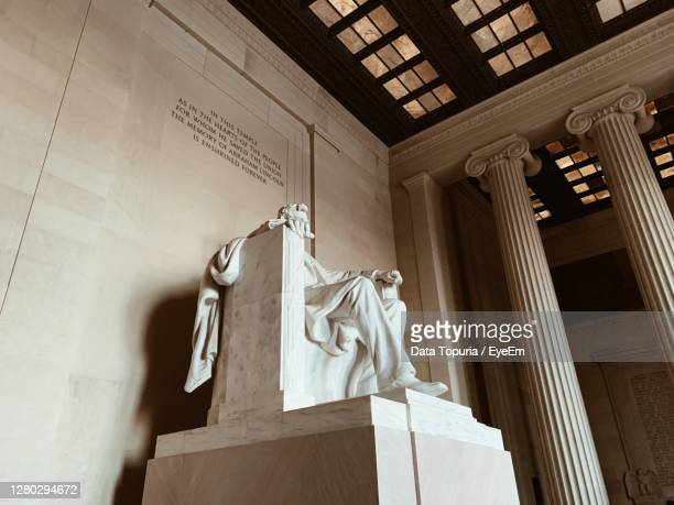 low angle view of statue against building - data topuria stock pictures, royalty-free photos & images